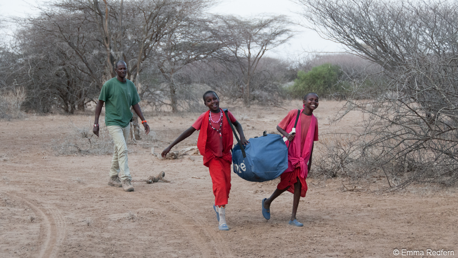 Girls carrying tents to the camp site